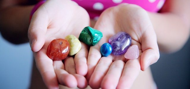 woman-holding-six-polished-stones-1147946