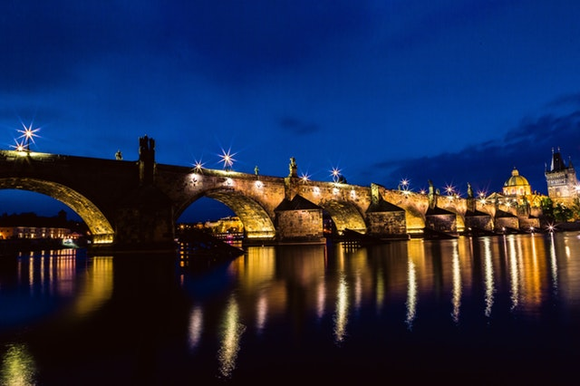 brown-and-black-concrete-bridge-during-night-161894